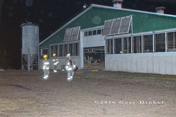 firemen inspect barn at night