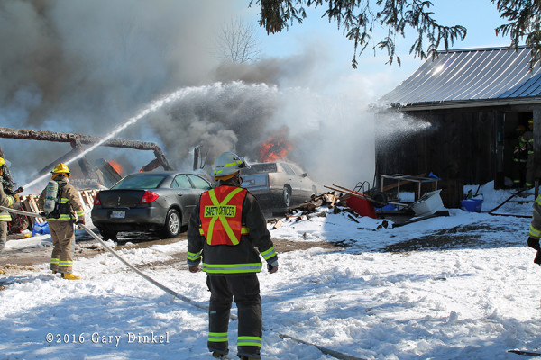 firefighters battle barn fire in the winter