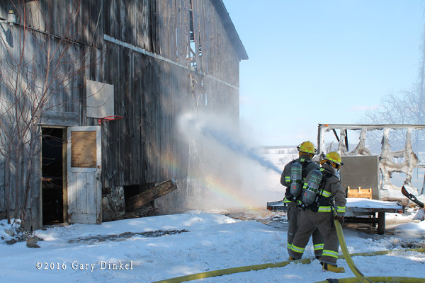 firefighters protect exposure during fire