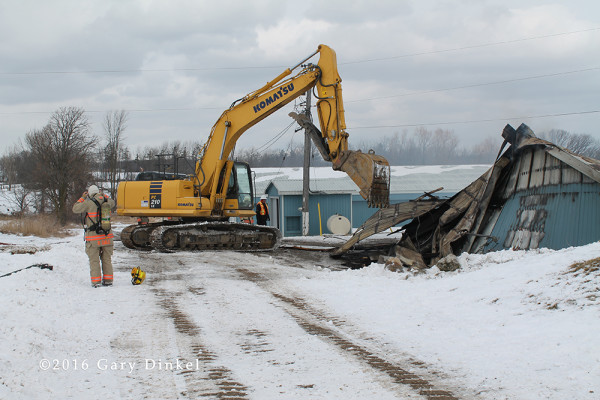 excavator tears down building after fire