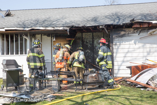 firemen overhaul after fire