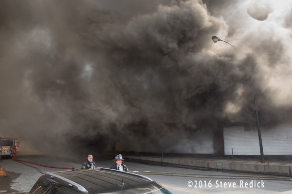 heavy smoke at commercial building fire