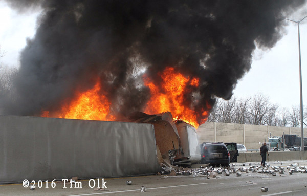 tractor-trailer on fire after rolling over