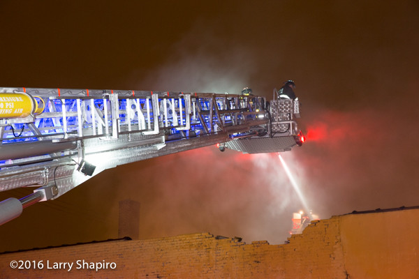 E-ONE tower ladder battling a fire in Chicago