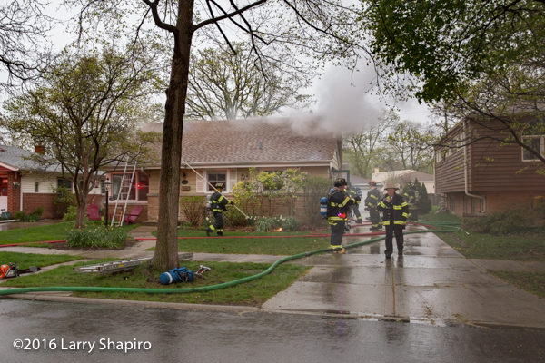 firefighters at Park Ridge house fire
