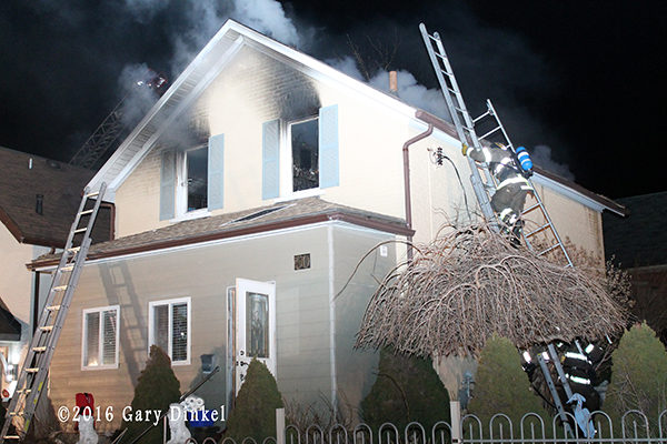firefighters in Kitchener Ontario battle a house fire