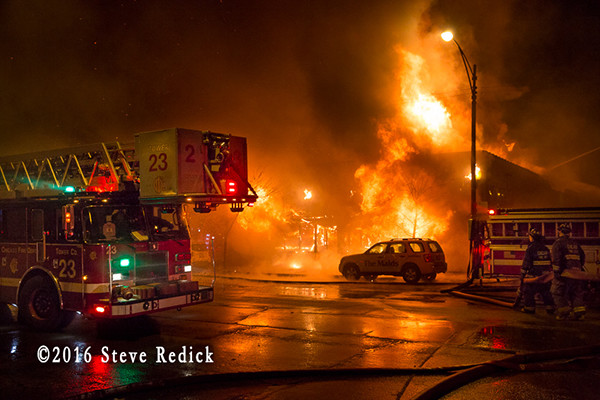 heavy fire from commercial building fire at night