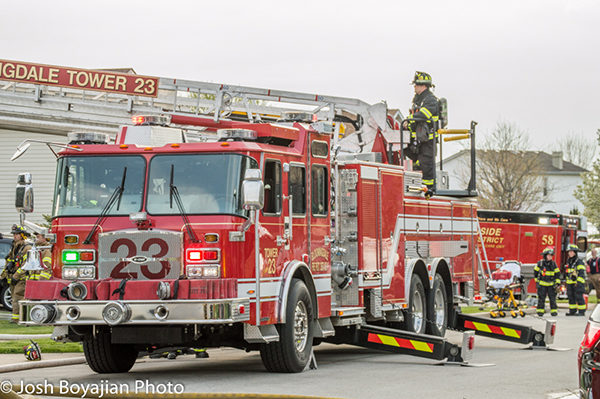 Bloomingdales Fire District tower ladder at work