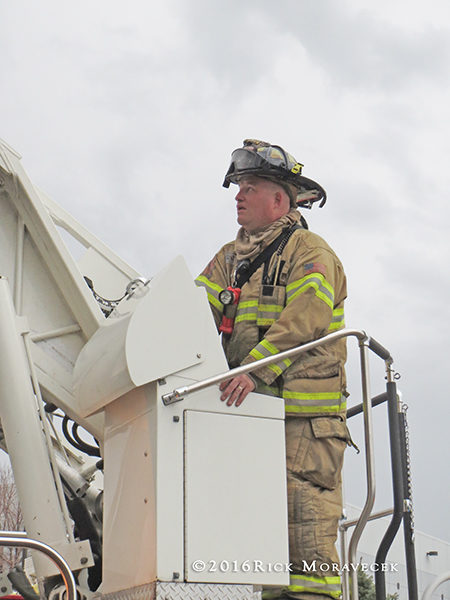 firefighter at turntable controls