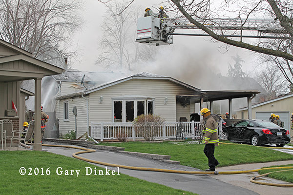 firefighters battle a house fire in Waterloo Ontario