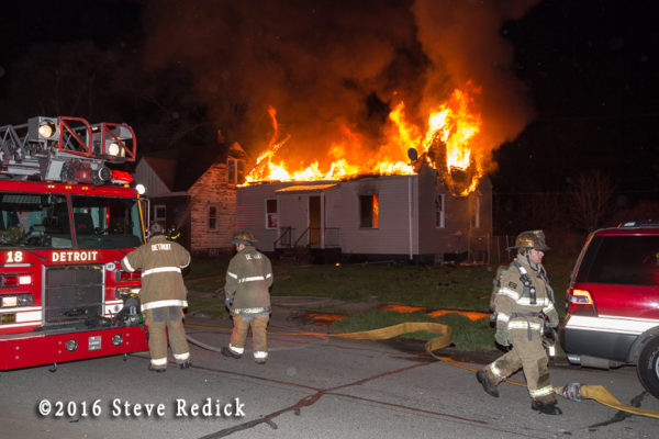 vacant house on fire at night
