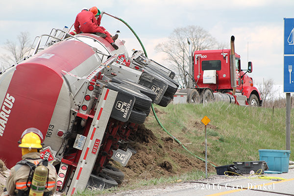 contractor offloads product from rolled over tanker truck