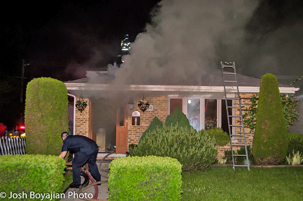 house fire with heavy smoke at night