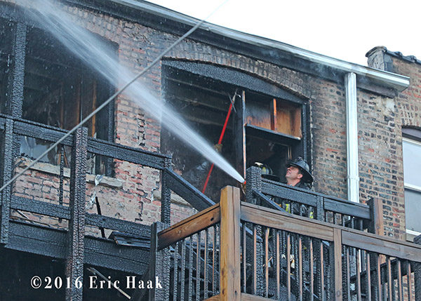 firefighter overhauls rear porches