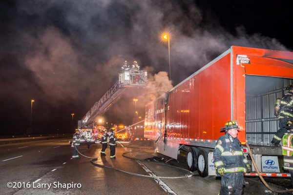 semi trailer fire at night