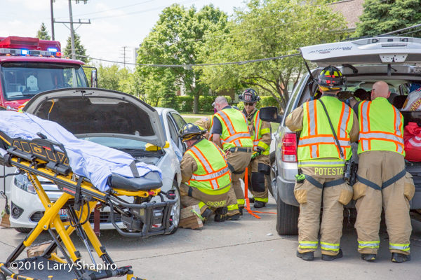 firefighters remove patient from car after crash