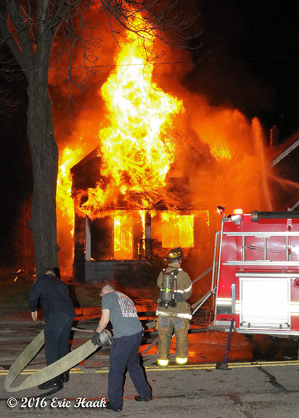 firefighters at fully engulfed house fire