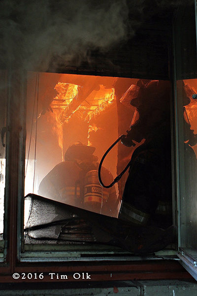 firefighters in kitchen with fire overhead