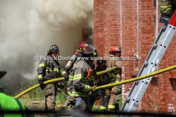 firefighters advance hose line