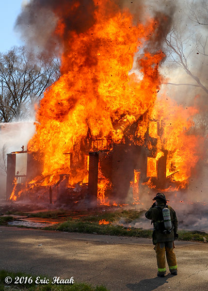 vacant house fully engulfed in flames