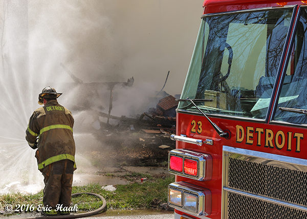 Detroit firefighter with hose line