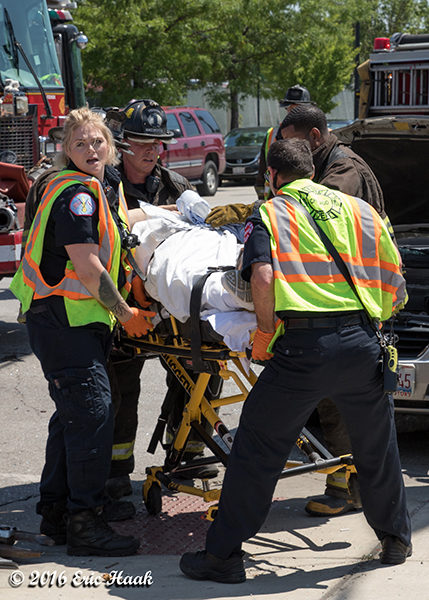 paramedics move accident victim on stretcher