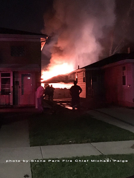 alley garage fully engulfed in flames