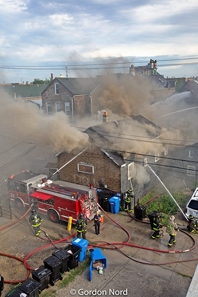 deck gun from fire engine in use during house fire