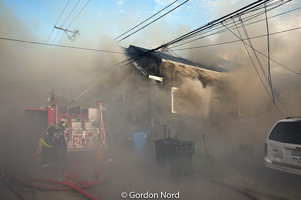 smoke from a fire in Chicago that spread to three homes