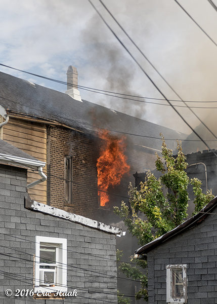 flames and smoke from house fire in Chicago