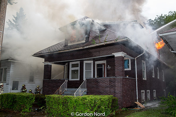 heavy smoke and flames from Chicago style bungalow