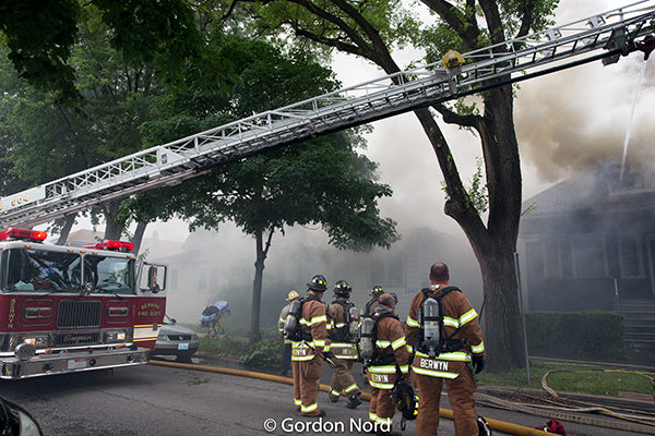 firefighters at house fire scene