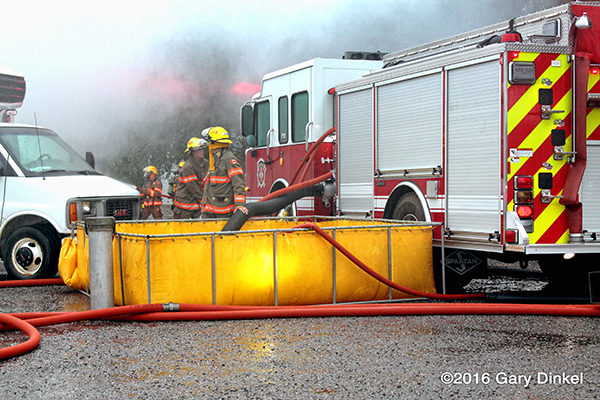 fire engine drafting from a portable tank