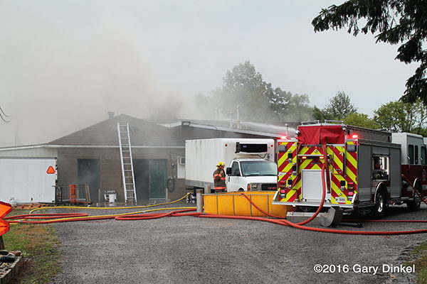 heavy smoke from building fire in Wilmot Township Ontario