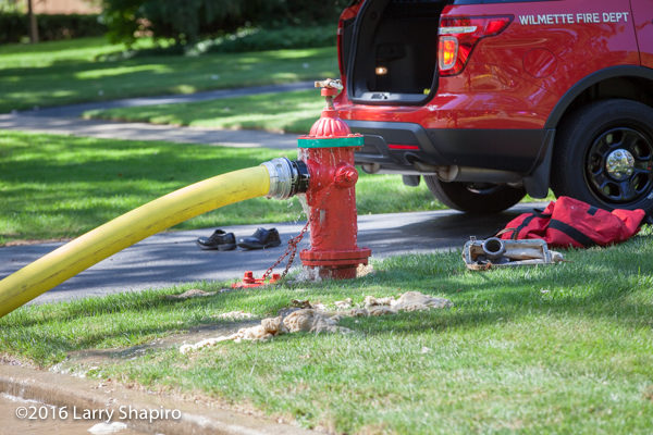 fire hydrant with hose connected