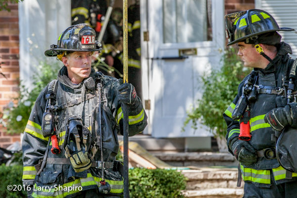 firefighter covered with insulation after fire