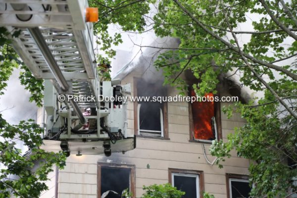 Pierce tower ladder working during a house fire