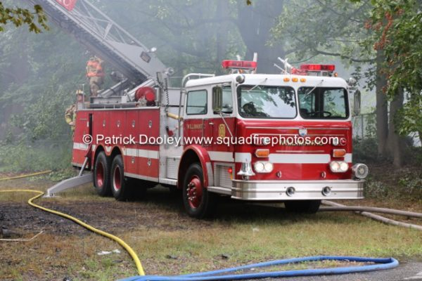 Maxim aerial ladder workiing at a fire