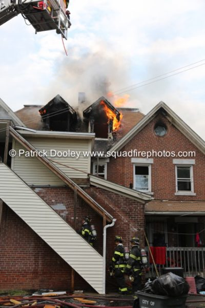 flames through roof of house fire