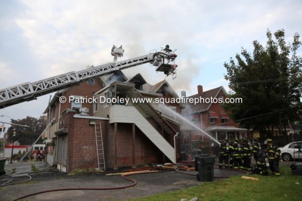 Sutphen tower ladder working at house fire