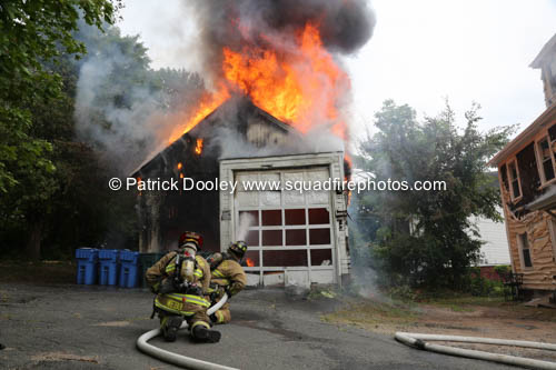 firefighters battle heavy fire from garage fire