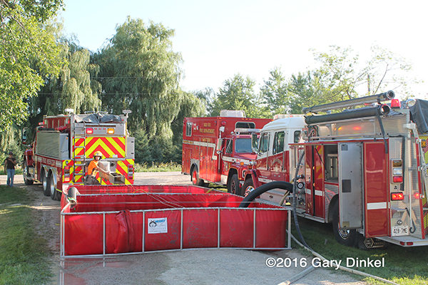 fire department fire engines draft from portable tanks