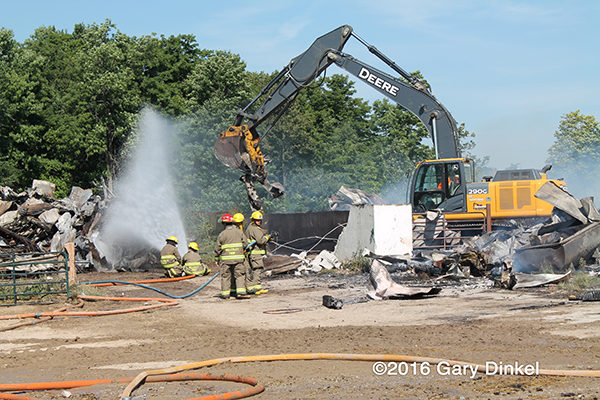 excavator assists firefighters after barn fire