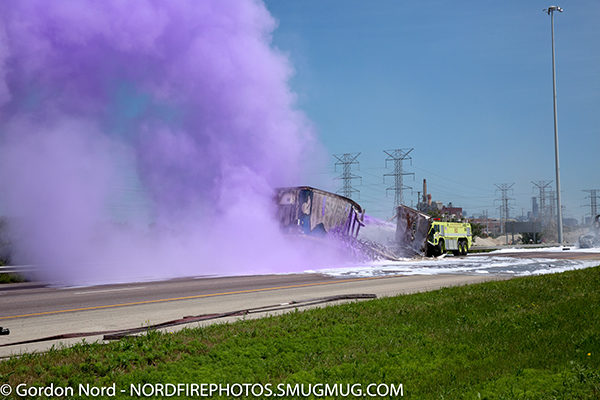 CFD airport crash truck at semi crash on a highway discharging purple K