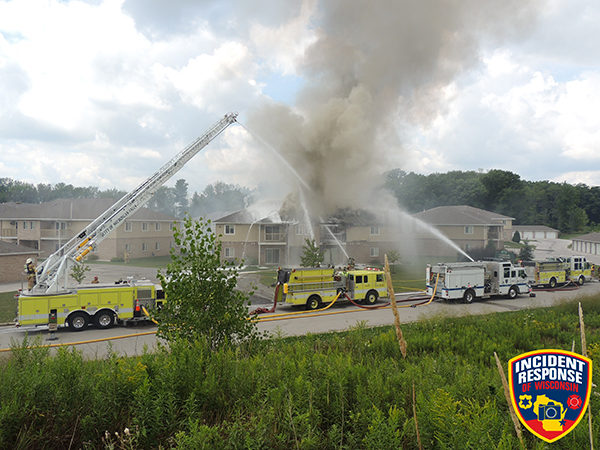 multiple fire trucks battle apartment building fire
