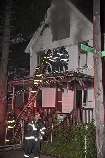firefighters enter window during night house fire