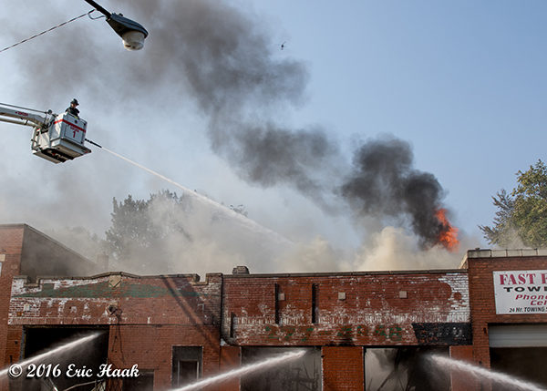 fire through the roof of a commercial building