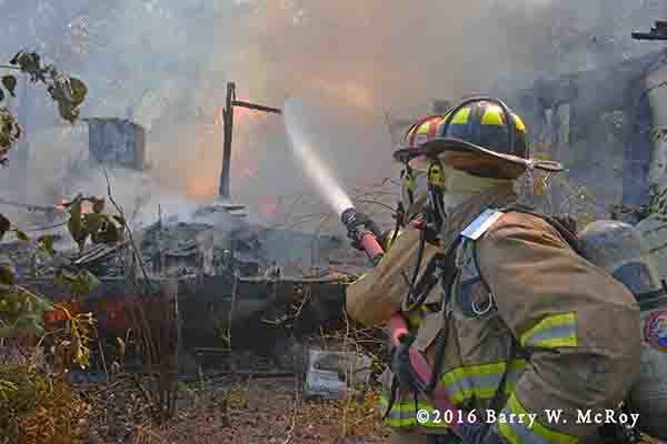 firefighters work after doublewide trailer home destroyed by fire