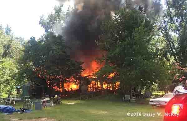 doublewide trailer home on fire