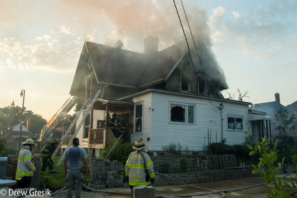 fire chief supervised firefighters during a house fire